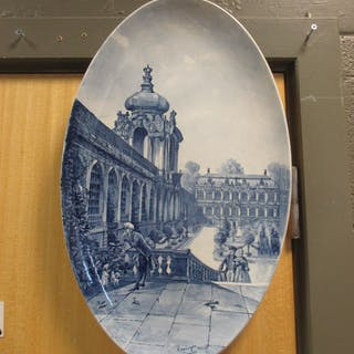 A pair of Continental porcelain blue and white oval plaques, one decorated