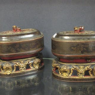 A pair of Chinese export oval laquered and gilt wood boxes , Qing
