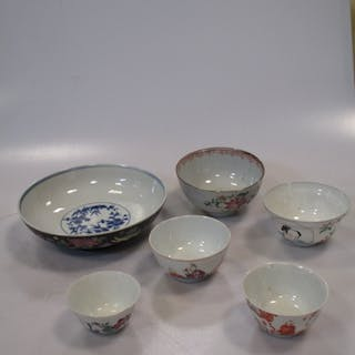 A Chinese ogee shaped tea bowl painted with figures, four other Chinese bowls