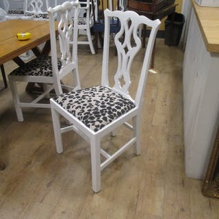 A set of eight white painted chippendale style chairs to include two