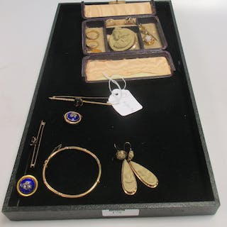 A travelling jewellery box containing a cameo brooch and earring suite