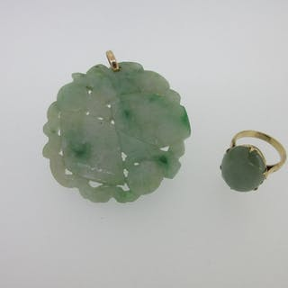 A late 19th century Chinese jadeite jade pendant together with a jadeite