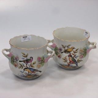 A pair of Meissen style cache pots (2)