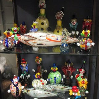 A collection of Murano glass clowns and a fish