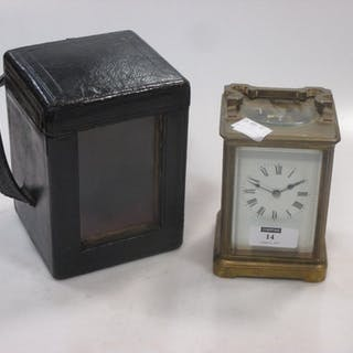 A basic French brass carriage timepiece, with travel case