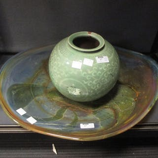 A large studio glass charger and a Chinese celadon vase