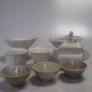 A group of eight Dehua and Dehua type cups, Qing Dynasty and later