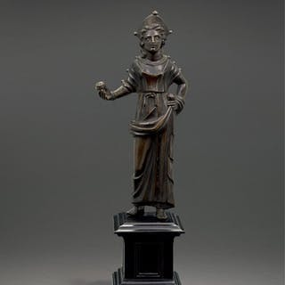 AN ETRUSCAN BRONZE FIGURE OF A GODDESS, CIRCA 2ND CENTURY B.C.