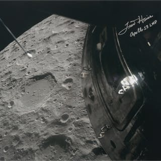 [APOLLO 13]. LUNAR FLYBY. COLOR PHOTOGRAPH SIGNED BY FRED HAISE