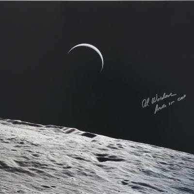 [APOLLO 15]. CRESCENT EARTHRISE VIEWED FROM LUNAR ORBIT. COLOR PHOTOGRAPH
