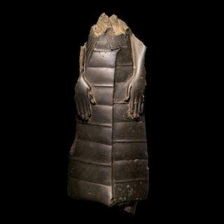 AN EGYPTIAN GRAYWACKE FIGURE OF A MAN, 12TH DYNASTY, 1938-1759 B.C.