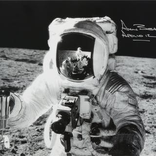 [APOLLO 12]. ALAN BEAN COLLECTING LUNAR SOIL SAMPLES. BLACK AND WHITE