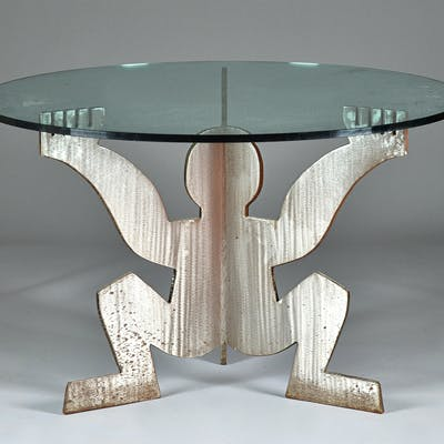 After Keith Haring 1958-1990; a circular glass top kitchen ...