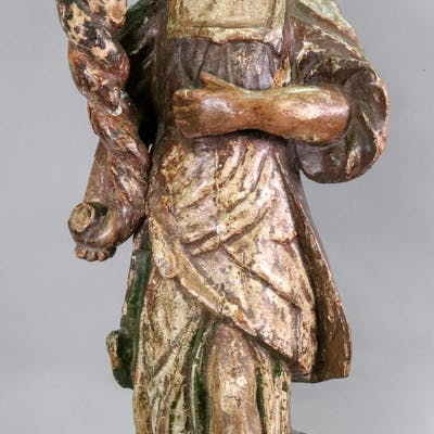 An Italian carved pine polychrome painted candlestick, 17th century