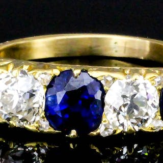 A modern 18ct gold mounted sapphire and diamond five stone ring