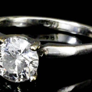 A modern 18ct white gold mounted solitaire diamond ring