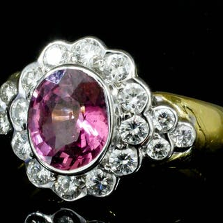 A modern 18ct gold mounted pink sapphire and diamond cluster ring