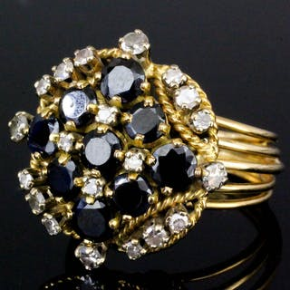 A gold coloured metal mounted sapphire and diamond cluster ring