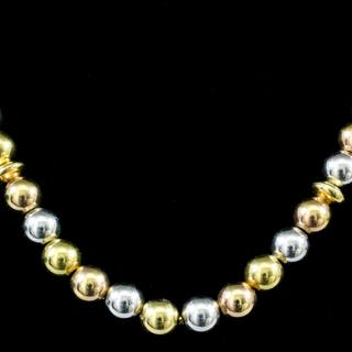 A modern 18ct gold necklace with yellow and white gold...
