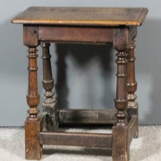 A 17th Century oak joint stool with moulded edge to top