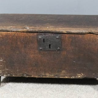 A 17th Century oak small plank coffer with moulded and chip carved edge to top
