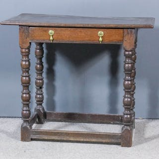 A 17th Century oak rectangular occasional table with moulded edge to top