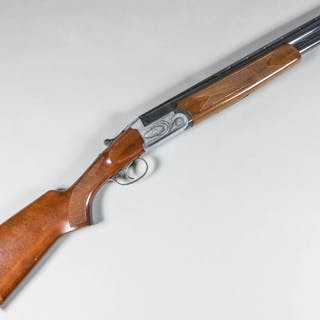 A 12 bore over and under shotgun by The Midland Gun Company