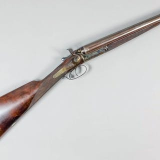 A good 12 bore side by side hammer action shotgun by Harrison of London