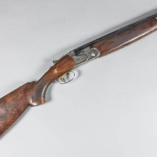 A 12 bore over and under shotgun by Beretta
