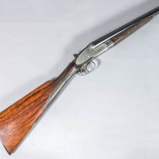 A good 12 bore side by side shotgun by Holland & Holland