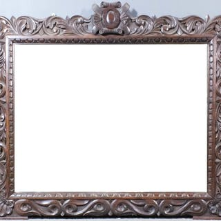 "A 19th Century oak framed rectangular wall mirror of ""17th Century"" design"