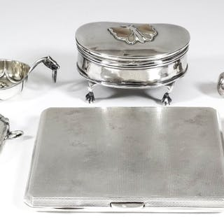 An Edward VIII silver rectangular cigarette case with engine turned ornament