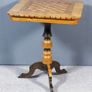 A Victorian walnut square tripod games table with canted corners