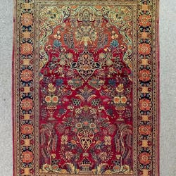 A Tabriz Rug Woven In Colours With Urns Of Flowers
