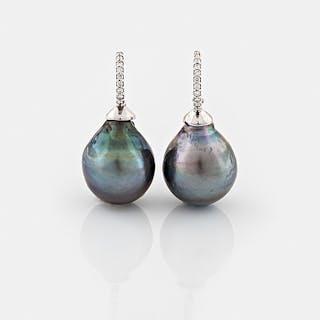 EARRINGS, A pair of cultured Tahiti pearl and brilliant cut diamond earrings.