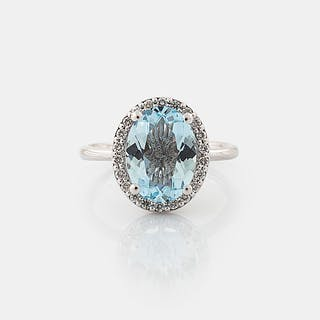 A aquamarine and brilliant cut diamond ring.