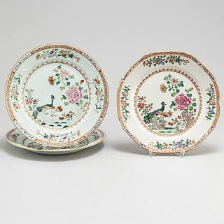 Three famille rose 'double peacock' plates, Qing dynasty, Qianlong (1736-95).