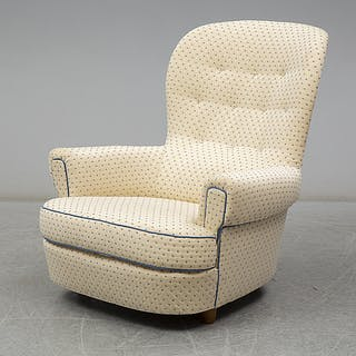 "A Carl Malmsten ""Jättepaddan"" armchair, late 20th or early 21th century."