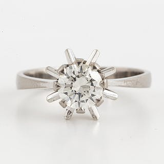 A 14K white gold ring set a round brilliant-cut diamond.