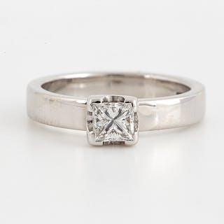 An 18K white gold ring set with a princess-cut diamond.