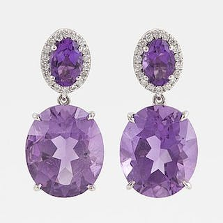 Oval faceted amethyst and brilliant-cut diamond earrings.