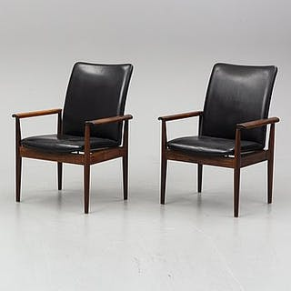 FINN JUHL, a pair of 'Diplomat' rosewood easy chairs from France &