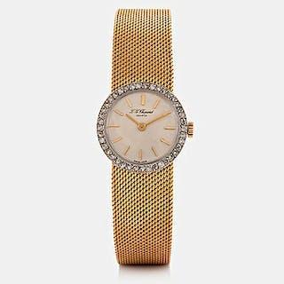 A Chopard wrist watch in 18K gold set with eight-cut diamonds.