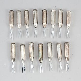 A set of seven con cob forks, sterling.