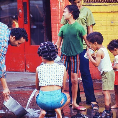 Mitchell Funk, Family at Fire Hydrant, Lower East Side (1969)