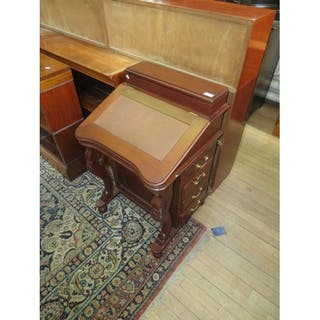 A Reproduction Mahogany Davenport Desk With Eight Drawers An