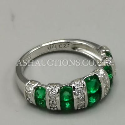 PRESENTED AS A SILVER (925) GREEN STONE SET RING