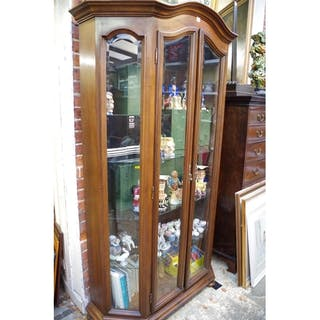 A Contemporary Walnut Display Cabinet With Bevelled Gl Cur S Barnebys