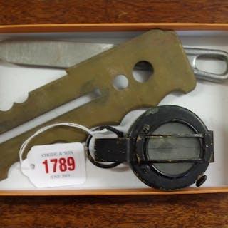 A World War II period compass; together with a brass bu...