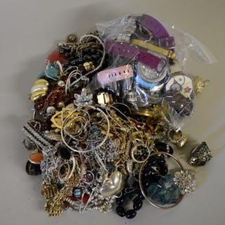 A quantity of costume jewellery and modern watches....